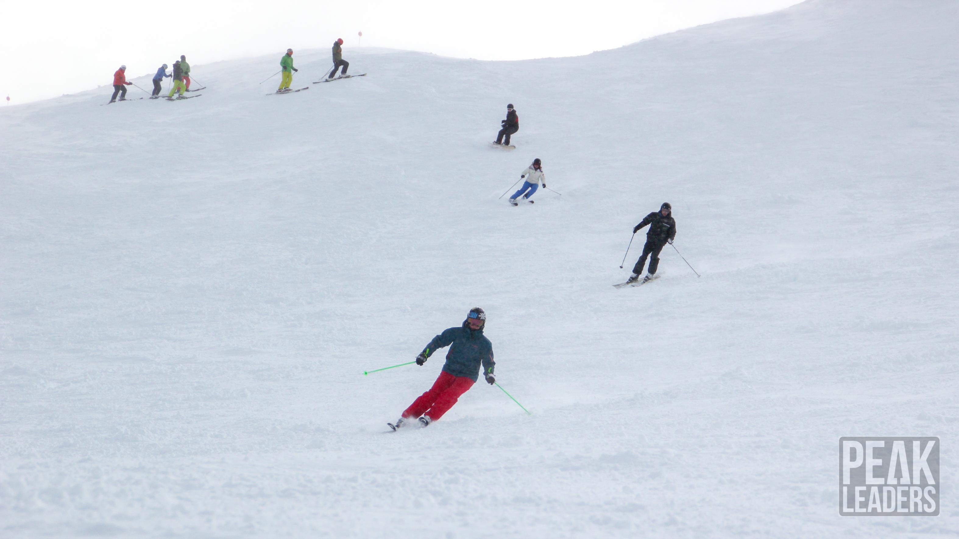 Ski Instructor Graduate coming down the slopes, enjoying some fresh pow