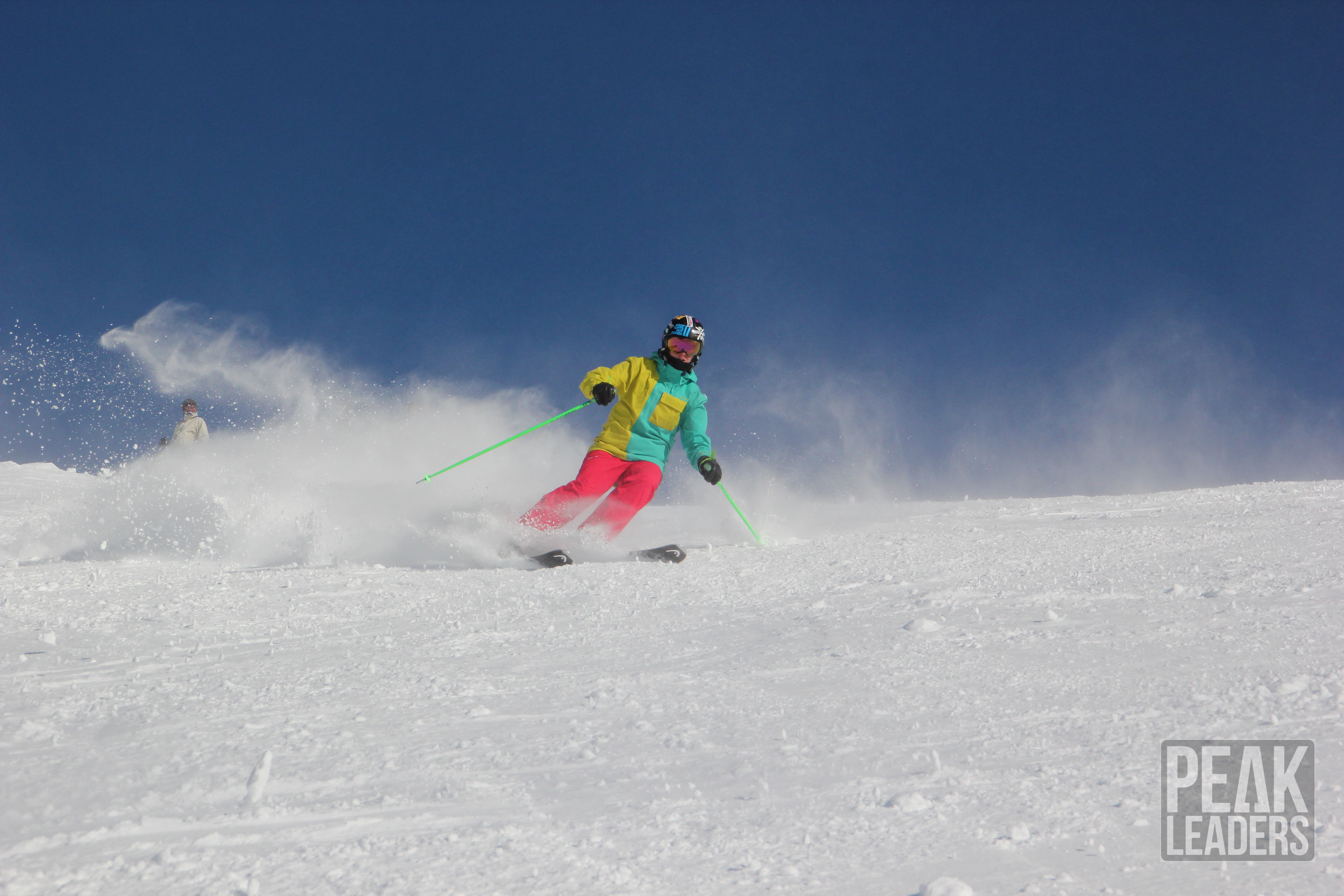 Fresh pow and blue skies on the mountain, practicing long radius turns